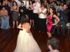 bride-and-guest-dance-in-middle-of-circle-to-music-of-detroit-party-band
