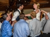 bride-and-groom-lifted-up-in-chairs-to-sounds-of-detroit-wedding-band