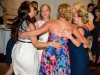 bride-embraces-girlfriends-at-metro-detroit-wedding-reception